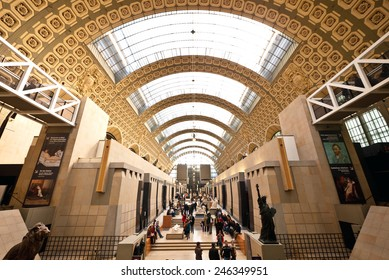 PARIS, FRANCE - FEBRUARY 19, 2013: Visitors in Musee d'Orsay. Since it's opening in 1986, Musee D'Orsay houses the largest collection of impressionist and post-impressionist masterpieces in the world.