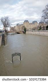 """Paris, France -February 2018: Floods of Paris, poster  """"Merci de votre visite"""" """"Thank you for your coming """" feet in the water. Floods of the Seine, Paris (France). Winter, 2018"""