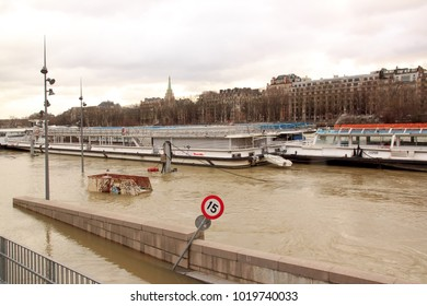 Paris, France - February 2018: The floods of the Seine, Paris France, winter, 2018. Boats fly in which, impossibility to navigate