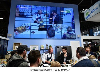 Paris; France - february 24 2019 : a chief is preparing a dish in the Paris International agricultural show