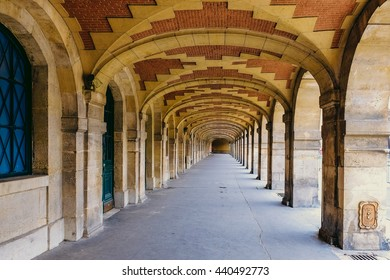 PARIS - FRANCE FEBRUARY 24,2016:Brick background texture. Brick arch ceiling in Place des Vosges (Marais, Paris)