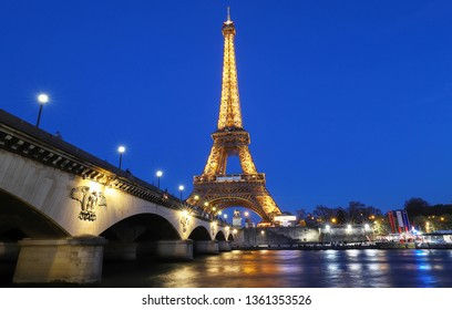 PARIS, FRANCE - February 25 , 2019 : Eiffel Tower illuminated at night. It's a wrought iron lattice tower named after the engineer Gustave Eiffel located on the bank of Seine river in Paris, France.