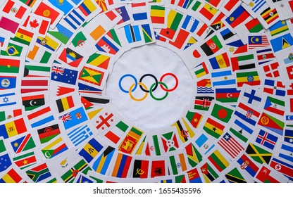 PARIS, FRANCE, FEBRUARY 25. 2020: Olympic rings and colorful world flags