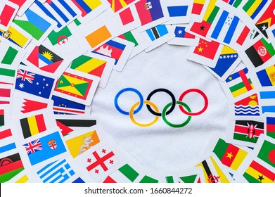 PARIS, FRANCE, FEBRUARY 25. 2020: Olympic spirit photo, olympic rings and world flags, Original wallpaper for summer olympic game in Tokyo 2020