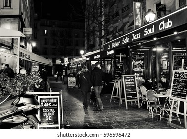 PARIS, FRANCE - FEBRUARY 26, 2017: Famous Parisian jazz clubs and pubs at Lombards street (Rue des Lombards).