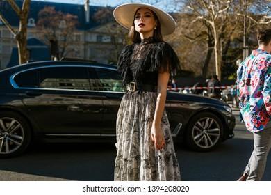 PARIS, FRANCE - FEBRUARY 26, 2019: Fashion stylist and writer Karina Nigay wears all Dior at DIOR show, during Paris Fashion Week Womenswear Fall/Winter 2019/2020.