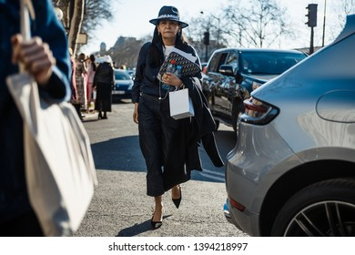 PARIS, FRANCE - FEBRUARY 26, 2019: A guest wearing Dior seen after DIOR show, during Paris Fashion Week Womenswear Fall/Winter 2019/2020.