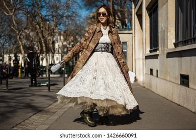 PARIS, FRANCE - FEBRUARY 26, 2019: Fashion stylist Faye Tsui wears all Dior seen outside DIOR show, during Paris Fashion Week Womenswear Fall/Winter 2019/2020.