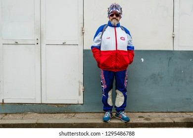 PARIS, FRANCE - FEBRUARY 27, 2018: Eccentric man wears hockey uniform is seen outside Dior show at Paris Fashion Week Womenswear Fall/Winter 2018/2019.