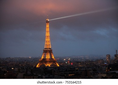 Paris, France - February 3, 2013. Eiffel Tower in night. Famous historical landmark on the quay of a river Seine. Romantic, tourist, architecture symbol.Night View from the Arch of Triumph