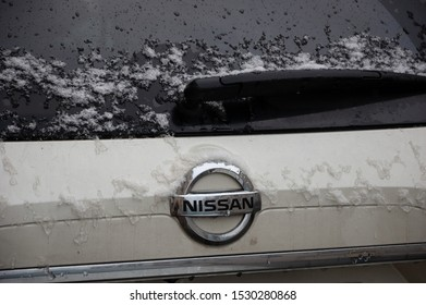 PARIS, FRANCE - FEBRUARY 5, 2018: Nissan automobile under snow in rare snowy day in winter in Paris. Closeup. Since 1999, Nissan has been part of the Renault Nissan Mitsubishi alliance.