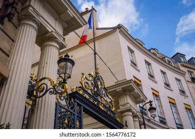 Paris, France - The French flag flying over the golden and metalwork-iron cast gate of the Ministry of Interior, in Beauvau Square (Place Beauvau)