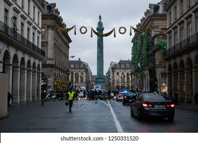 Paris, France, Gilets jaune 1.12.18, Traffic is interrupted as police blocks the road to place de Vendôme as the Gilets Jaune protest gets overwhelming. A single protester walks away.