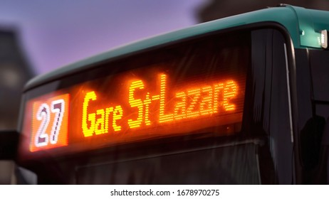 """PARIS, FRANCE: Iconic Modern Bus 27, which Cuts Paris City Centre from Porte d'Ivry to Gare Saint-Lazare. The Bright and Colorful Display Reads: """"27 Gare St-Lazare"""". Evening, dusk. DECEMBER 30, 2018"""