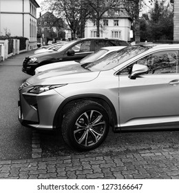 Paris, France - Jan 1, 2018: LEXUS RX 450h luxury silve SUV hybrid car parked on French street square iamge black and white
