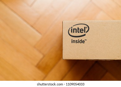 PARIS, FRANCE - JAN 10, 2018: New laptop computer cardboard box on wooden floor. Latest intel inside CPU processor logotype