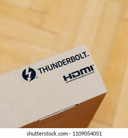 PARIS, FRANCE - JAN 10, 2018: New laptop computer cardboard box on wooden floor. Latest intel inside CPU processor with thunderbolt connection and HDMI