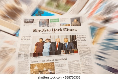 PARIS, FRANCE - JAN 21, 2017: The New York Times above major international newspaper journalism headlines Donald Trump, Barack Obama, Melania Trump and Michele Obama inauguration as the 45th President