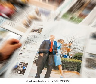 PARIS, FRANCE - JAN 21, 2017: Man holding Die Welt above major international newspaper journalism featuring headlines with Donald Trump and Melania Trump inauguration