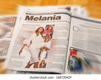 PARIS, FRANCE - JAN 21, 2017: Algemeen Dagblad Dutch magazine above major international newspaper journalism featuring portrait of Melania Trump inauguration as the 45th President  in Washington, D.C