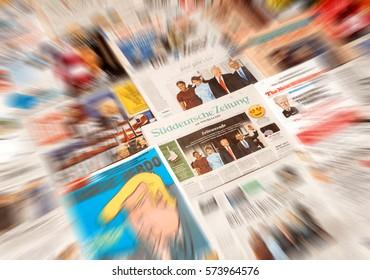 PARIS, FRANCE - JAN 21, 2017: Major international newspaper journalism Suddeutsche Zeitung featuring headlines with Donald Trump, Barack Obama, Melania Trump and Michele Obama at inauguration