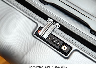 PARIS, FRANCE - JAN 22, 2018: Closeup detail of a Samsonite suitcase briefcase with focus on the logo and TSA combination lock password number