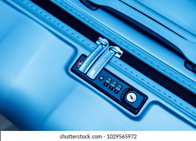 PARIS, FRANCE - JAN 22, 2018: Closeup detail of a Samsonite suitcase briefcase with focus on the logo and TSA combination lock password number in blue business tone