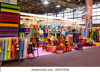 PARIS, FRANCE - JAN. 25, 2015: People visit stands at the International Lingerie Show in Paris where over 20,000 buyers meet 500 exhibitors from 37 different countries.