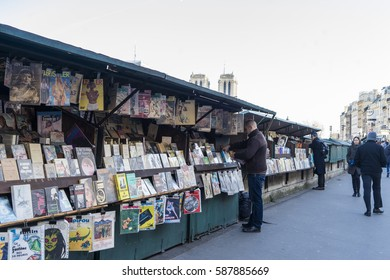 PARIS, FRANCE - Jan 6,2017 : Famous second-hand book market on quay of river Seine near cathedral Notre Dame.