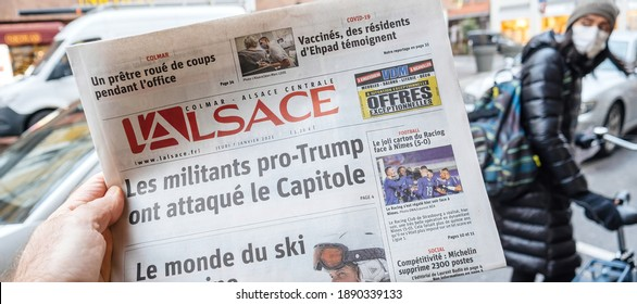 Paris, France - Jan 7, 2020: French newspaper l'Alsace front page show storming of the U.S. Capitol by supporters of U.S. President Donald Trump on January 07, 2021