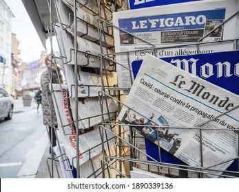 Paris, France - Jan 7, 2020: French newspaper Le monde on press kiosk market stall with headlines COVID Coronavirus new mutation exapnds - city background