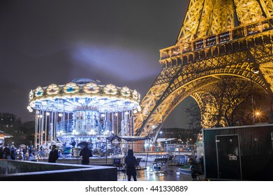 Paris, France - January 03, 2016: Eiffel Tower : Light Performance Show in Paris. Part of Eiffel tower with carousel, Paris Night. The Eiffel tower is visited tourist attraction in France. Flare light