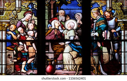 PARIS, FRANCE - JANUARY 04: Saint Genevieve giving sight to his mother in the presence of Saint Marcel, stained glass window in Saint Severin church in Paris, France on January 04, 2018.