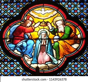 PARIS, FRANCE - JANUARY 05: Crowning of the Virgin Mary, stained glass window in the Basilica of Saint Clotilde in Paris, France on January 05, 2018.