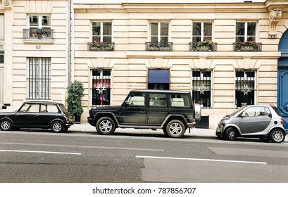 Paris, France - January 06, 2014: different types of cars on the street in the center of the city