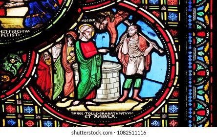 PARIS, FRANCE - JANUARY 09: Jesus heals a lame man, stained glass window from Saint Germain-l'Auxerrois church in Paris, France on January 09, 2018.