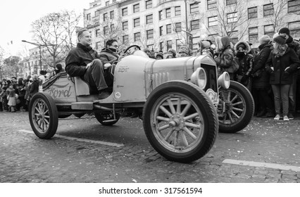 PARIS, FRANCE - JANUARY 1, 2015: Antique Ford car participates in New Year Parade on Avenue des Champs-Elysees. Colorful New Year Parade is annual event.