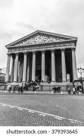 PARIS, FRANCE - JANUARY 1, 2016: Eglise de la Madeleine, one of most famous Paris churches. Madeleine Church was designed in its present form as a temple to glory of Napoleon army. Black and white.