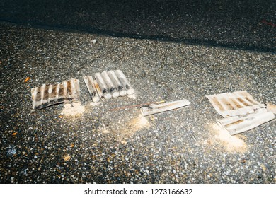 Paris, France - January 1, 2018: Burnt Fireworks and petards garbage left on the street asphalt after winter holiday celebration in the French capital Paris