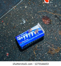 Paris, France - January 1, 2018: Fireworks and petards garbage box left on the street asphalt after winter holiday celebration in the French capital Paris