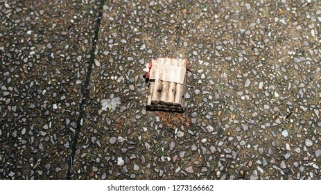 Paris, France - January 1, 2018: Fireworks and petards garbage left on the street asphalt after winter holiday celebration in the French capital Paris