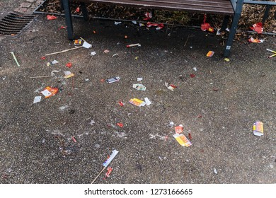 Paris, France - January 1, 2018: Multiple Fireworks and petards garbage left on the street asphalt after winter holiday celebration in the French capital Paris