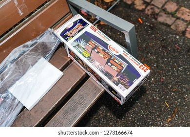 Paris, France - January 1, 2018: Fireworks and petards garbage left on the park public bench after winter holiday celebration in the French capital Paris