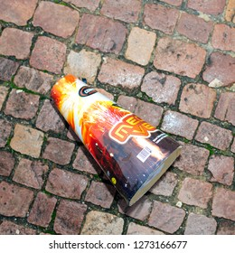 Paris, France - January 1, 2018: Part of Fireworks and petards garbage left on the street asphalt after winter holiday celebration in the French capital Paris