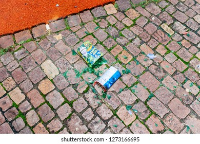 Paris, France - January 1, 2018: Broken glass and fireworks and petards garbage left on the street asphalt after winter holiday celebration in the French capital Paris