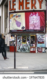 PARIS, FRANCE - JANUARY 1: Pedestrians pass the theater Le Mery in the Montmartre area on January 01, 2014 in Paris, France.