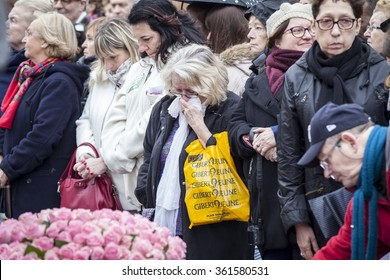 PARIS, FRANCE - January 10, 2016: woman crying at ceremony to commemorate victims of the bombing and shooting rampage, Charlie Hebdo terrorist attack and of Marches Republicaines demonstration