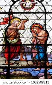 PARIS, FRANCE - JANUARY 10: Baptism of the Christ, stained glass window in the Basilica of Notre Dame des Victoires in Paris, France on January 10, 2018.