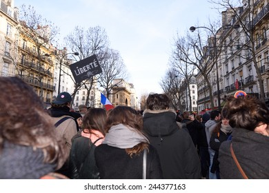 Paris, France - January 11, 2015:  demonstration in solidarity with the attack against Charlie Hebdo in Paris, France on 11 January, people holding a sign.