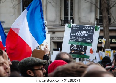 Paris, France - January 11, 2015: People with french flags during the anti-terrorism rally in Paris